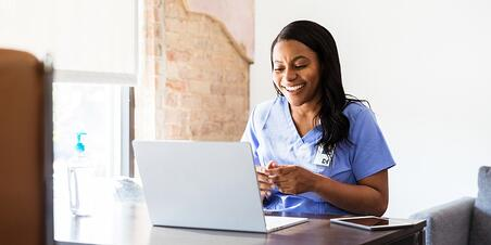 happy-doctor-talks-with-patient-during-telemedicine-appointment-picture-id1254705139 (1)